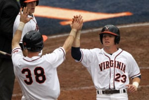 <p>Virginia first baseman Mike Papi (38) and left fielder Derek Fisher (23) high five after scoring during the first inning of the second game of a doubleheader on Sunday in Charlottesville, Va. Photo / Ryan M. Kelly / The Daily Progress</p>