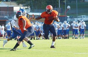 <p>DeAngelo Hunt rumbles around the end for a gain on the Hornets' second possession during Friday's successful scrimmage against Madison.</p>
