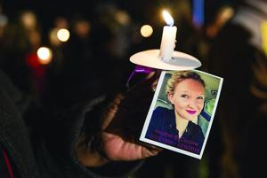 "<div style=""direction: ltr; font-family: Tahoma; color: #000000; font-size: 10pt;""><p>Candles with a photograph tied purple ribbon of Heather Ciccone were passed out during a vigil at Harrison Road Park in Spotsylvania on Dec. 9, 2015.</p></div>"