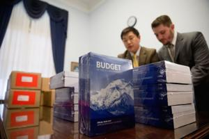 <p>Copies of the President Barack Obama's fiscal 2017 federal budget are unpacked after being delivered to the House Budget Committee Room on Capitol Hill in Washington, Tuesday, Feb. 9, 2016. President Barack Obama unveils his eighth and final budget, a $4 trillion-plus proposal that's freighted with liberal policy initiatives and new and familiar tax hikes, sent to a dismissive Republican-controlled Congress.</p>