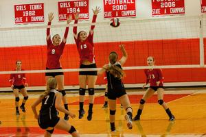 <p>Riverheads' Jennifer Callison (9) and Nyssa Stapleton (15) are up to defend against the return by Gap's Emily Chandler (1).</p>