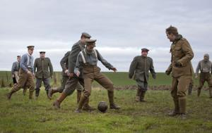 <p>Re-enactors, from various living history groups, are dressed in World War I British and German uniforms as they kick around a soccer ball during a re-enactment of the 1914 Christmas Truce</p>
