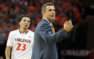 <p>Virginia head coach Tony Bennett motions to the bench as Virginia guard London Perrantes (23) looks on during the first half of an NCAA basketball game on Wednesday in Charlottesville, Va. Photo / Ryan M. Kelly / The Daily Progress</p>
