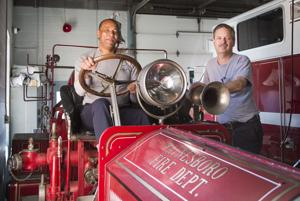 <p>(From left) Jeff Parrish and Danny McCormick sit on Old Betsie at the Waynesboro Fire Department.</p>
