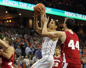 <p>Virginia guard Malcolm Brogdon (15) drives to the hoop past Wisconsin forward Frank Kaminsky (44) during the second half of an NCAA basketball game on Wednesday in Charlottesville, Va. Photo / Ryan M. Kelly / The Daily Progress</p>