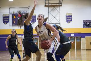 <p>The Little Giants' Allie Coburn (44) goes up for a basket during the game against Spotswood on Friday evening.</p>