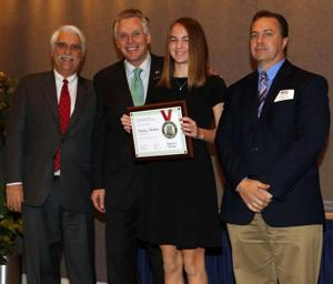 "<p>Culpeper Middle School student Brynley Meadows, center, was the regional winner of the Virginia Municipal League's essay contest on the topic, ""If I Were Mayor."" For winning, she received $150 and got to meet Gov. Terry McAuliffe, second from left. At far left is VML President Ron Rordam, mayor of Blacksburg and at right is Culpeper Mayor Mike Olinger.</p>"