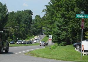 <p>Traffic travels along Bus. 29/Madison Road Tuesday morning in an area where the town is considering a reduction in speed.</p>