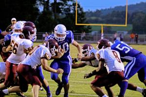 <p>Fort's Evan Stickley (40) plows throw the Brookville line to put the Indians up 6-0 earlier this season.</p>