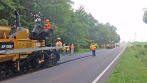 <p>Area construction crews recently apply asphalt to a local roadway.</p>