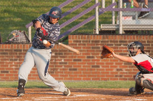 <p>Generals batter Garrett Russini (16) zeros in on the ball and hits a single.</p>