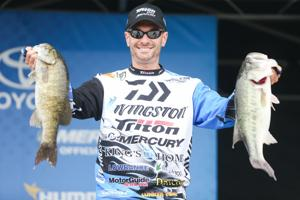 <p>Springville's Randy Howell shows two of his five bass at the Friday weigh-in. Howell is third overall with 35 pounds, 2 ounces total. The Bassmaster Elite Series event concludes Sunday. For more photos, visit decaturdaily.com.</p>