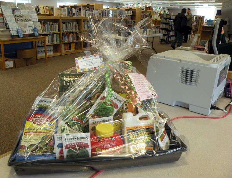 library baskets of books silent auction slated for april. Black Bedroom Furniture Sets. Home Design Ideas