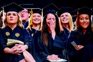 Graduates enjoy their big day at Kibbie Dome