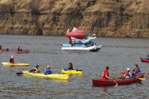 Large flotilla takes message to the water