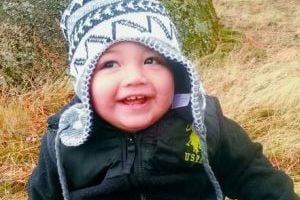 <p>Draeven Blaze Young smiles during the fall as he enjoys a hike on Moscow Mountain with his family.</p>