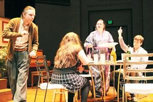 <p>Sophomore Matt Cummins, foreground, sophomore Gabriella Montemarano, sitting, senior Katrina Wulf, background, and sophomore Sam Woods act out a scene from 'Tribes' in Whitcomb Lee Conservatory.</p>