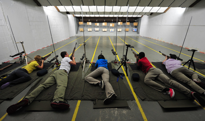 Dothan ROTC students Amelia Duty, Christopher Cody Dean, Jessica Majors, Joshua Onadeko and Joshua Herring (from left) practice shooting with their air rifles inside the school's shooting range on Thursday afternoon.