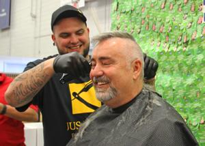 Shaving hair for Muscular Dystrophy Association