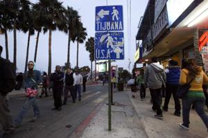 High school students walk toward the U.S. border in Tijuana, Mexico.