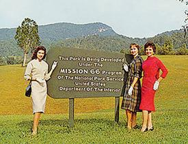 <p>Women by Mission 66 sign courtesy National Park Service.</p>