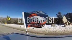 Broncos window flag around Estes Park