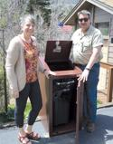 <p>Cindy and Bob Liddell show their new BearSaver trash can.</p>