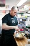 A Chop Shop cook preps ginger salad for lunch service.