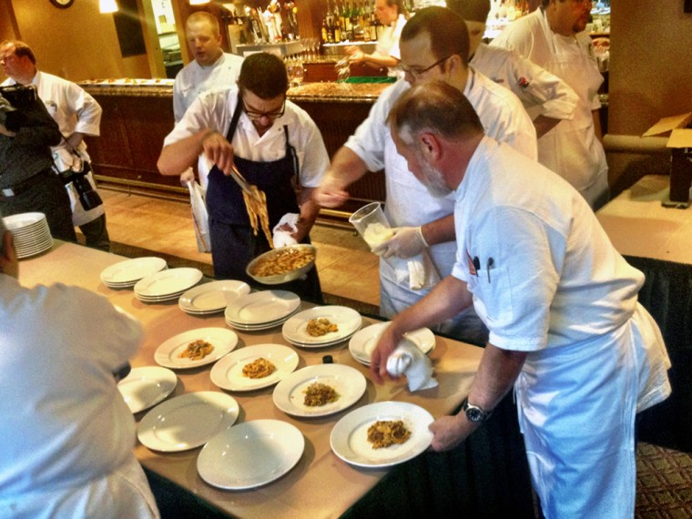 Chefs plating dishes at the Epicurean Extravaganza, a Gourmet Wine Dinner