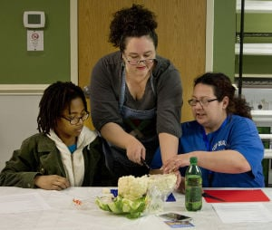 Mothers and teenage daughters cooking class