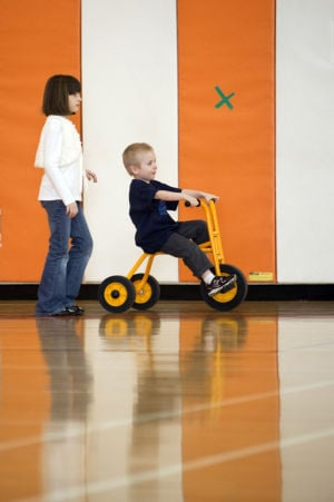 Gym class pairs second-graders with special-needs students
