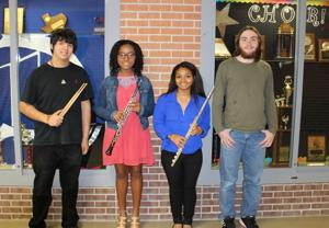 <p>Four Dickinson High School musicians were recently honored with All-State honors, the highest achievement a Texas music student can receive. Pictured, left to right, are All-State Band honorees Esteban Ganem, Ozioma Okeke and Kelci Bellard; and All-State Choir honoree Adam Funderburg.</p>