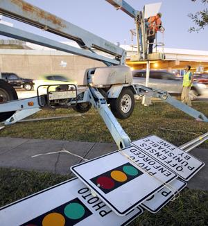 Red-light cameras coming down in League City