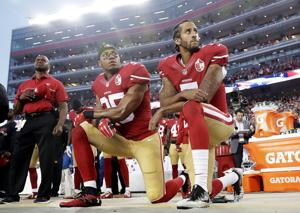 <p>San Francisco 49ers safety Eric Reid (35) and quarterback Colin Kaepernick (7) kneel during the national anthem before a game against the Los Angeles Rams on Monday, Sept. 12, 2016, in Santa Clara, Calif. The dozen NFL players who have joined Kaepernick's protest of social injustices by kneeling or raising a fist during the national anthem have faced vitriolic, sometimes racist reactions on social media and at least one has lost endorsements. None are deterred by the blowback.</p>