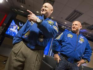 <p>NASA astronaut Scott Kelly, left, laughs with reporters while standing with his twin brother, former astronaut Mark Kelly, before a news conference at Johnson Space Center in Houston on March 4. Scott Kelly recently returned to Earth after 340 days in space. He and his brother, who remained on Earth, are being studied to determine the effects of long-term space flight.</p>
