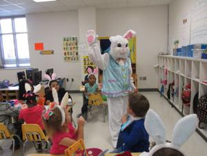 """<p>Peter Cotton Tail went hopping down the bunny trail, otherwise known as FM 2004, to visit Hitchcock Primary School during the Easter holiday. Students were """"egg-cited"""" about the special visitor and enjoyed the hugs and treats that Peter provided.</p>"""