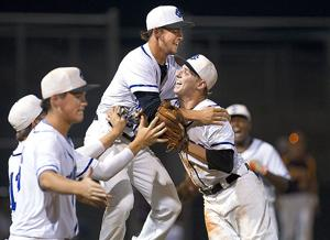 <p>Clear Springs' Jacob Vasquez and David Burts (right) embrace as they celebrate with teammates after defeating Deer Park, 5-2, onFriday, May 22, 2015in League City.</p>