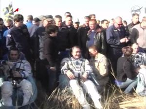 Space station crew returns to earth