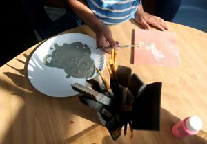 <p>A child at the Resource and Crisis Center of Galveston County shelter paints a tile Friday, July 22, 2016, for the annual Casino for a Cause fundraiser this Saturday. The unique works of art are for the attendees of the annual event.</p>