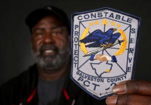 <p>Terry Petteway, recently retired after 24 years as constable for precinct 2, holds the patch he wore when first elected in 1992.</p>