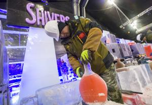 <p>LinDong Zhou, a member of an ice sculpting team from Harbin, China, carves a bottle out of ice while while working on Moody Gardens' Ice Land: A Caribbean Christmas Thursday, Oct. 13, 2016. The team will craft over two million pounds of ice into artistic displays and attractions including an ice slide. It will officially open on Nov. 12 and run until Jan. 8.</p>