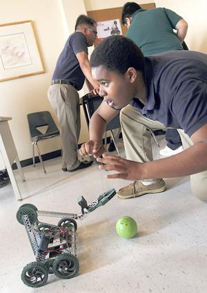 Ambassadors Preparatory robotics  class teaching students new skills