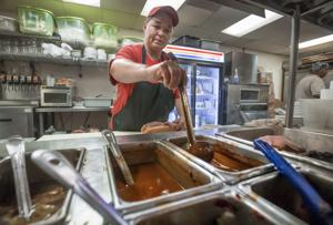 <p>Michelle Skipper, a manager at Gus' Restaurant in Texas City, prepares a meal Thursday, June 16, 2016. Gus', where even managers have for years earned overtime pay for overtime work, is a rarity in an industry worried about the cost of complying with new federal wage-and-hour rules.</p>