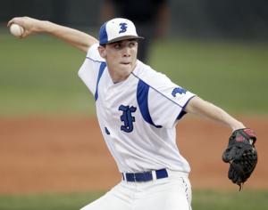 <p>KEVIN M. COX/The Daily News Friendswood's Jordan Wood pitches in the top of the second inning of a game against Santa Fe on Tuesday night April 19, 2011 at Bobby Black Field in Friendswood. The Mustangs defeated the Indians 7-6.</p>