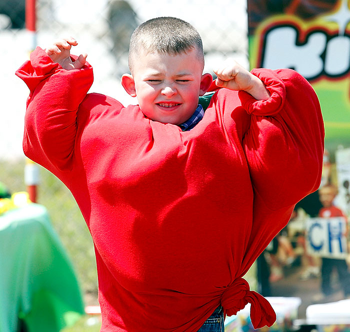 Strong man flexes for Kids Celebration show