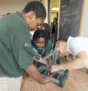 Ambassadors Preparatory robotics  class teaching students new skills