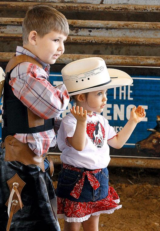 Tot holds brother's hat at Mutton Bustin' competition