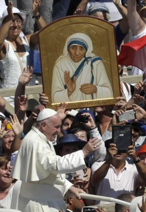<p>Pope Francis passes in front a portrait of Mother Teresa at the end of a canonization ceremony in St. Peter's Square at the Vatican on Sept. 4. Thousands of pilgrims thronged to St. Peter's Square for the canonization of Mother Teresa, the tiny nun who cared for the world's most unwanted and became the icon of a Catholic Church that goes to the peripheries to tend to lost, wounded souls.</p>