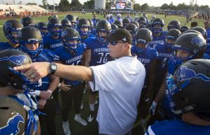 <p>Friendswood head coach Robert Koopman speaks to his players before the Mustangs' season opening home game against Texas City at Henry Winston Stadium in Friendswood Friday, Aug. 28, 2015.</p>