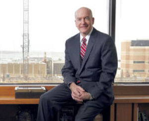 <p>From his office, Dr. David L. Callender, president of The University of Texas Medical Branch in Galveston, has a view of the new Jennie Sealy Hospital construction. The $438 million project got under way last year. It is expected to be open in 2016.</p>